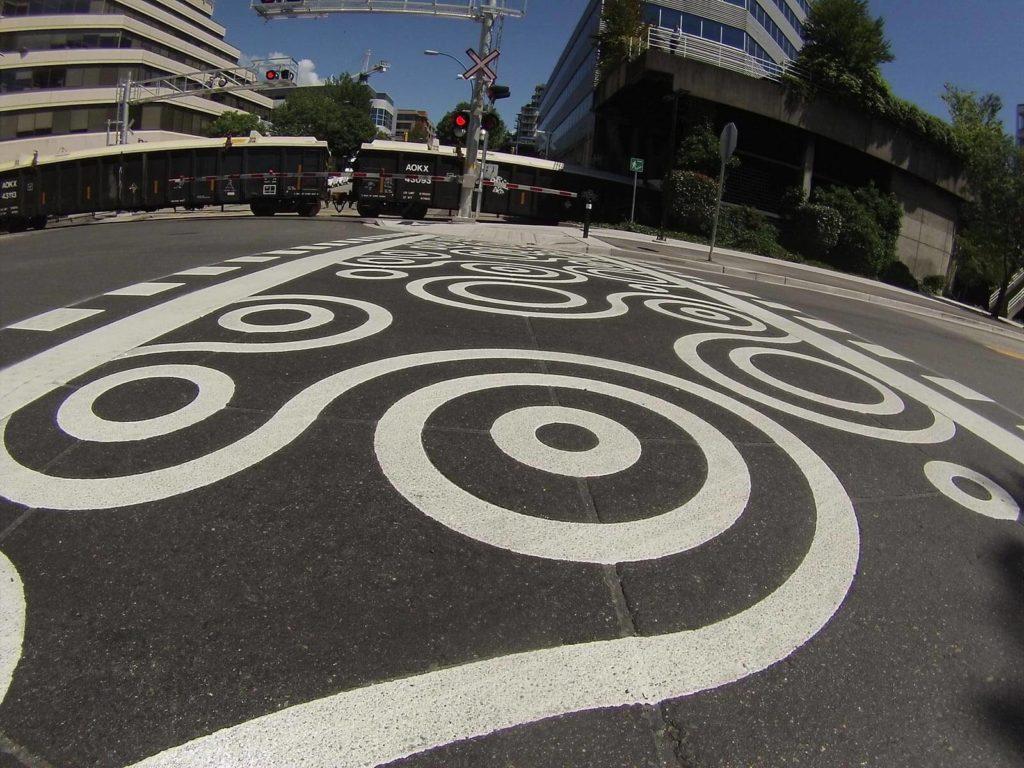 Duratherm decorative stamped asphalt crosswalk on pacific spirit trail North Vancouver BC Canada
