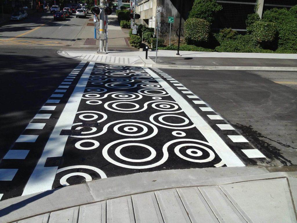 Spirittrail stamped asphalt crosswalk using DuraTherm preformed thermoplastic inlay