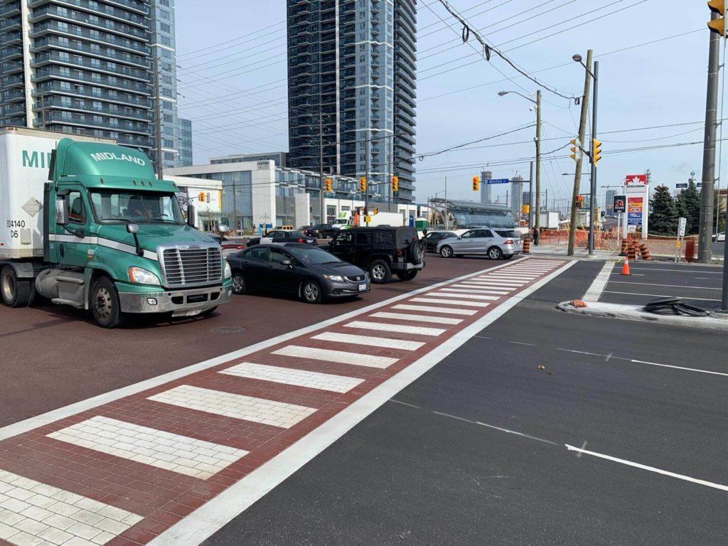 enhanced stamped asphalt crossswalk truck crossing