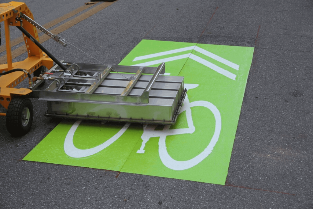 Preformed thermoplastic green priority bike lane installation with streetheat