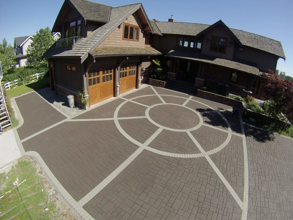 Stamped asphalt driveway with circular freature scaled
