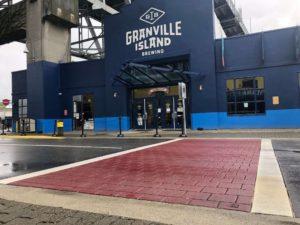 decorative crosswalk with stamped asphalt at granville island beer